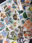 100 x 10p mixed postage stamps